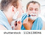 a handsome man in the bathroom... | Shutterstock . vector #1126138046