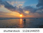 Young Surfer Silhouette With...
