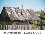 radio antenna on the house.... | Shutterstock . vector #1126157738