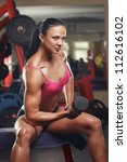 girl with dumbbells in the gym | Shutterstock . vector #112616102