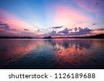 sunset view to lake peten itza... | Shutterstock . vector #1126189688