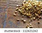 a mound of gold on a old wooden ... | Shutterstock . vector #112621262