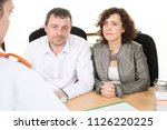 couple sitting in front of the...   Shutterstock . vector #1126220225