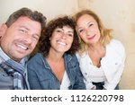 three friends middle age make a ...   Shutterstock . vector #1126220798
