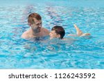 father and son learning to swim ... | Shutterstock . vector #1126243592