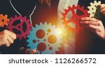 business team connect pieces of ... | Shutterstock . vector #1126266572