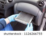 replacing an old car cabin air... | Shutterstock . vector #1126266755