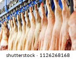 pig carcasses cut in half... | Shutterstock . vector #1126268168