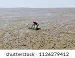 lifeguard on a mud sledge... | Shutterstock . vector #1126279412