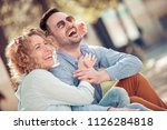 smiling lovely young couple... | Shutterstock . vector #1126284818
