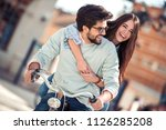 cute couple on a bike ride on a ... | Shutterstock . vector #1126285208