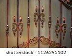 wrought iron gates  ornamental... | Shutterstock . vector #1126295102