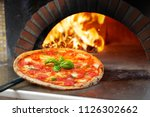 hot margherita pizza baked in... | Shutterstock . vector #1126302662
