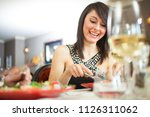 couple having dinner in a... | Shutterstock . vector #1126311062