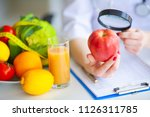 diet. doctor nutritionist hold... | Shutterstock . vector #1126311785