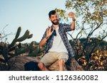 man with backpack taking selfie ...   Shutterstock . vector #1126360082