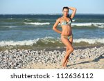 girl in a swimsuit on the beach | Shutterstock . vector #112636112