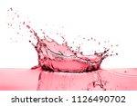 splashing red wine on white... | Shutterstock . vector #1126490702