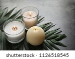 burning wax candles and tropic... | Shutterstock . vector #1126518545