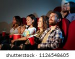 group of friends sitting in... | Shutterstock . vector #1126548605
