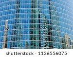 wall of a modern skyscraper... | Shutterstock . vector #1126556075