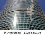 wall of a modern skyscraper... | Shutterstock . vector #1126556105