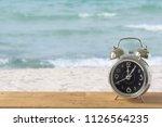 old retro clock on sand beach | Shutterstock . vector #1126564235