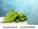 fresh ripe cos lettuce on... | Shutterstock . vector #1126565828
