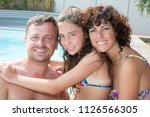happy family on pool side house ... | Shutterstock . vector #1126566305