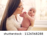 young mother  with newborn baby | Shutterstock . vector #1126568288