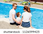 happy young family in white t...   Shutterstock . vector #1126599425
