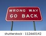 Wrong Way Go Back Road Sign.