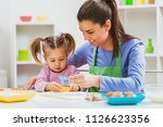 happy mother and daughter are... | Shutterstock . vector #1126623356