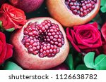 ripe fruit pomegranate and... | Shutterstock . vector #1126638782