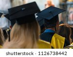 students wearing gowns and hats ... | Shutterstock . vector #1126738442