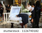 editorial use only. burial... | Shutterstock . vector #1126740182