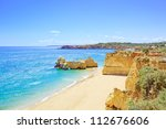 beach and rock formation known... | Shutterstock . vector #112676606