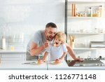 happy father and son eating... | Shutterstock . vector #1126771148