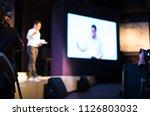 presenter presenting on stage... | Shutterstock . vector #1126803032