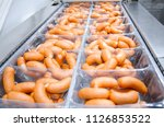 sausages. packing line of... | Shutterstock . vector #1126853522