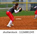 Softball Player Making A Throw...