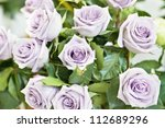 Stock photo bunch of violet and purple beautiful roses 112689296