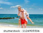 happy couple in love on beach... | Shutterstock . vector #1126905506