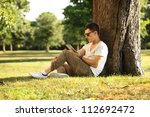 Guy Sitting Beneath The Tree...