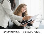 two business colleagues... | Shutterstock . vector #1126927328