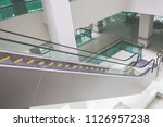 modern escalator in shopping... | Shutterstock . vector #1126957238