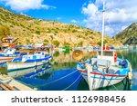 boats in a port in one of greek'... | Shutterstock . vector #1126988456