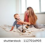 mother with little child son... | Shutterstock . vector #1127016905
