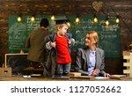 teacher drawing at classroom in ... | Shutterstock . vector #1127052662