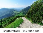 sope with view on cross paths... | Shutterstock . vector #1127054435